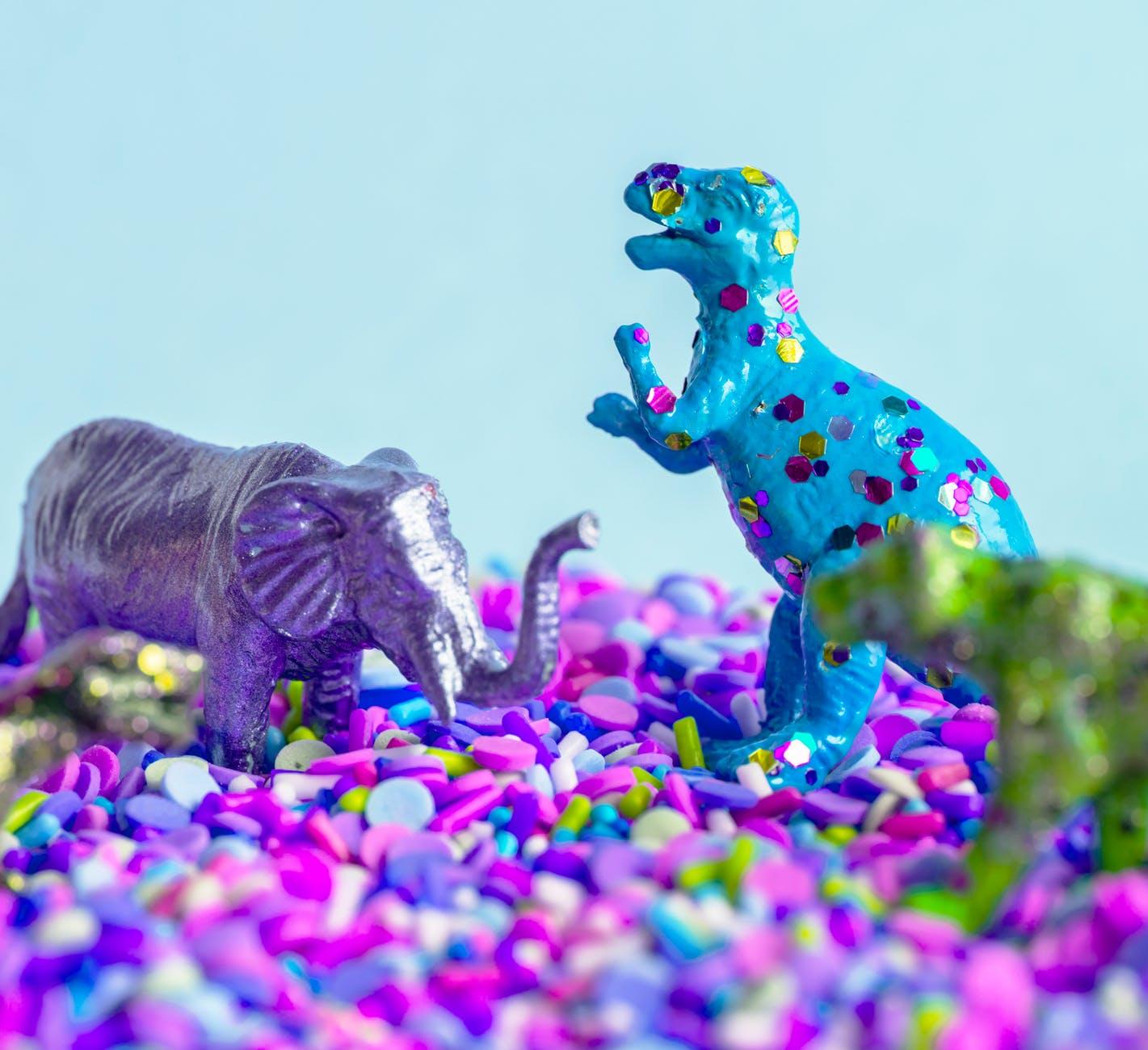 gray and blue dinosaure ffigurines